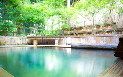 Open-air Onsen Bath enclosed by forest trees  Perfect way to relax your body and soul!